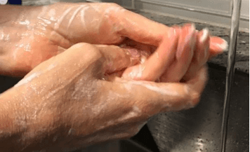close up of hands being washed: Is C. Diff Dangerous for Patients?