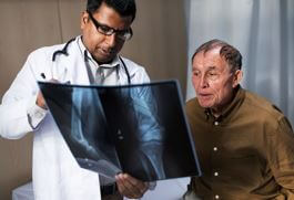 photo doctor explaining xray to patient - too many tests and treatments