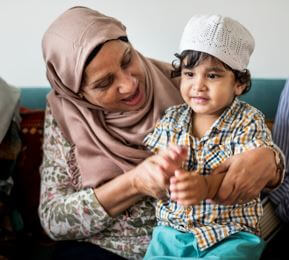 photo muslim grandmother playing with grandchild