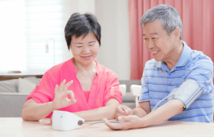 couple taking blood pressure measurement at home