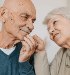 photo of older couple holding hands